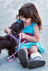 Girl and Dog Playing